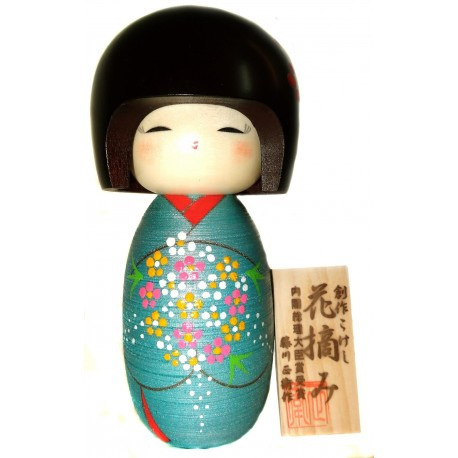 Kokeshi doll - Hanatsumi. Traditional Japanese wooden doll.