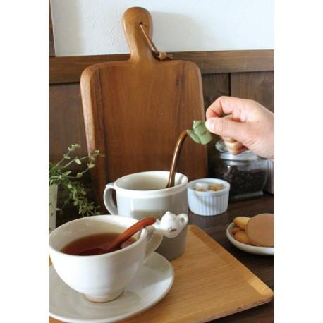Cuillère à café rigolote en forme de théière ou pot à café.